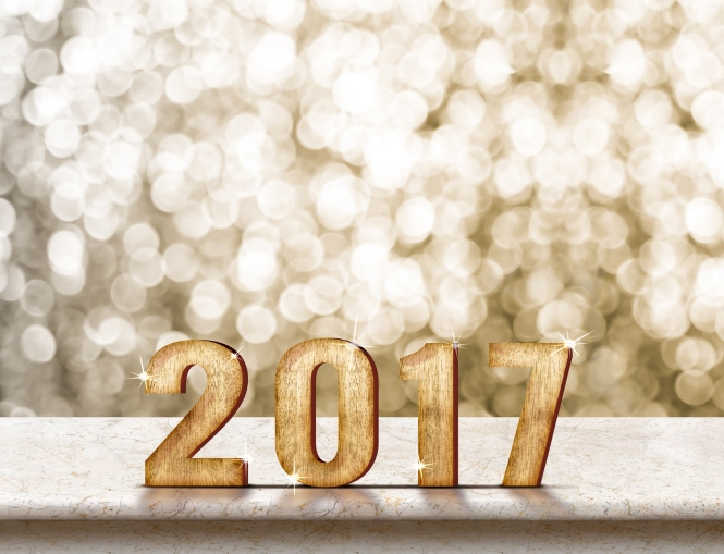 Happy New Year 2017 wood texture on marble table with sparkling gold bokeh wall,Holiday concept.